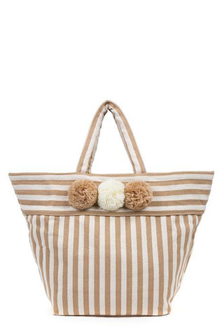 Valerie 3-Pom Tote by JadeTribe. A smaller version of the best selling beach bag. Nautical textile with three pom pom detail. Makes the perfect summer beach tote with interior pocket. This does not have cross body straps. This bag is vegan. Measurements L23 x H14 x W5 inches