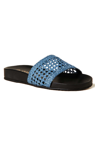 Kaanas Spring 2018 Akumal Pool Slide in Blue. Woven raffia slide sandals in bright blue. Open wicker weave strap. Flat profile. Open toe. Unlined. Made in Colombia. Rubber sole. 0.75 inch platform. Color blue black. Handwoven raffia. Leather innersole. Textured rubber outsole. Sizes 6 7 8 9 10.
