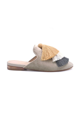 Kaanas Spring 2018 Mompox Tassel Slide. Plush velvet slip on mule with oversized colorblock tassle detail. Velvet base. Rubber sole. Pointed toe. Open back slide style. Three tier oversized tassel on top. Slip-on. Made in Colombia. Color grey white yellow. Sizes 6 7 8 9 10.