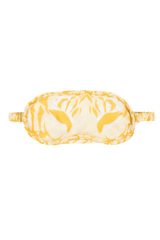 Tiger Print Satin Eyemask by Kapara. Hand printed in India. Tiger print eye mask on modal satin, featuring padded eye bed and elastic strap. Hand-screen printed in Jaipur. 10% of the profits go towards Tears for Tigers wildlife conservation projects. Color yellow white. 100% modal satin.