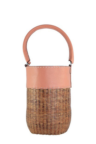 "The Lucie bucket tote by Kayu Spring 2018 is made of woven wicker, and features a leather panel and handle. A drawstring lining keeps all of your belongings safe. This is the perfect statement straw bag. Measurements 9.5"" H x 6.5"" diameter. Kayu fair trade bags are carefully handcrafted by women cooperatives in the Philippines, Indonesia and Malaysia, using indigenous techniques that have been passed down through the generations."