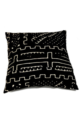 Mudcloth Bogolon Pillow by Mjita. Handwoven in Mali. Mudcloth or Bogalnfini is produced in Mali from hand loomed cotton woven on a narrow nomadic loom. The fabric is then cut and sewn in a family-run workshop in South Africa to produce each unique pillow. Color black. 100% cotton.