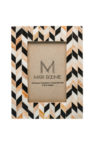 Artemis Frame by Matr Boomie. Handmade in India. Display your most treasured memories in this frame made of cruelty-free, ethically sourced bone in a mosaic chevron pattern inlay. Handmade by artisans in Sahranpur, India. Color black brown white. 100% upcycled bone.