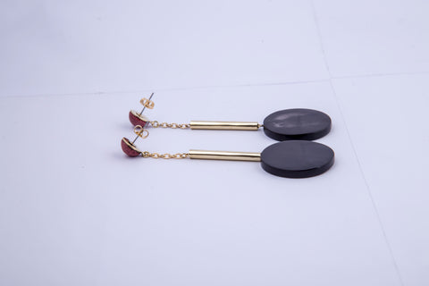 Accompany Exclusive Soko Black Horn Nairobi Drop Earring. Tiered pendulum drop earring. Hand dyed bone bead at post. Cast brass tube bead. Brass chain. Hand carved horn medallion. Post setting for pierced ears. 2.5 inch drop from post. Color black clay gold. 100% brass hardware. Dyed bone and ankole horn. One size.