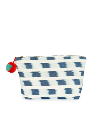 "Brushstroke Ikat Cristina Cosmetic Pouch by Mercado Global. This lightweight travel pouch folds neatly into luggage or expands to a gusseted base to hold your daily necessities upright. Water resistant lining inside pouch and tassel at zip pull. Perfect pouch to carry your summer essentials to the beach! 100% cotton Water resistant lining. Height: 7"" Width (top): 11.5"" Width (bottom): 8.5"" Depth: 3.5"""