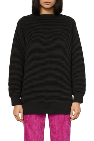 Mara Hoffman Fall 2018 Mac Sweater in Black. Long sleeved ribbed crew neck sweater featuring 3 side button detail. Made in Peru. Color black. 100% baby alpaca. Sizes x-small small medium.