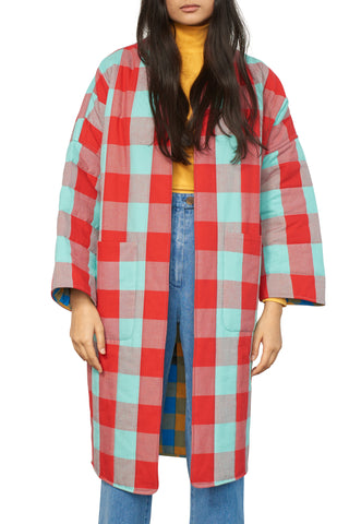 Mara Hoffman Fall 2018 Willow Reversible Jacket in Playford Plaid. Quilted reversible jacket in red blue and yellow plaid. Lightly padded long sleeve open jacket featuring two front patch pockets. Red and aqua plaid reverse to yellow and blue. Open front. Side patch pockets. Reversible. Slightly oversized fit. Made in India. Color red blue yellow. 100% organic cotton. Sizes x-small small medium.