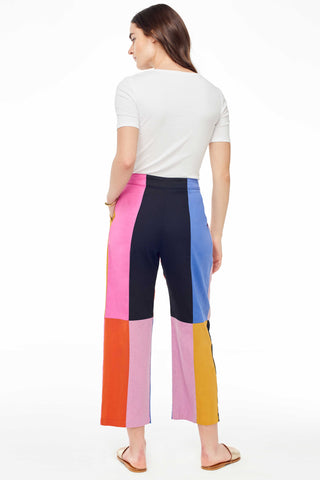 Mara Hoffman Spring 2018 Audre high waisted pant in rainbow patchwork. Modern colorblock cropped trouser pant. Features pleating at front, side pockets and side zipper. Pleated trouser style ankle crop pants. Hidden side zipper closure. Side slant hip pockets. Pleating at waist. Color block print. Trouser styling. Ankle length. Hook-and-eye closure. Size 4 measures 26.5 inch inseam. 12.5 inch rise. Color black blue pink yellow red lavender. 100% organic cotton. Size 0 2 4 6 8.