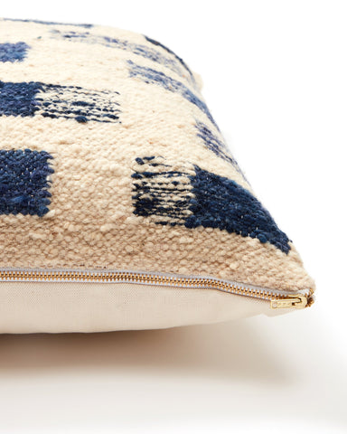 "The Shadow Pillow by Minna was handwoven on a pedal loom by skilled artisans in Totonicapan, Guatemala. Spot clean. Brass zip enclosure. 100% wool, cotton backing. Insert included. Ethically made. Due to the nature of handcrafted goods, each pillow may differ slightly. Available in Cream and Indigo. 20"" x 20"""