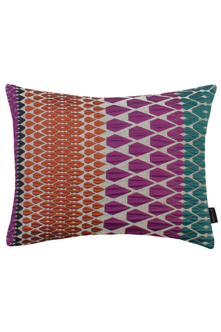 Calypso Present Cushion by Margo Selby. Inspired by the forms of cut jewels, and woven in a rich multi-colored scheme Calypso is an iconic Margo Selby fabric. Woven using mixed fibers including a heat shrink yarn, which creates a tension in the cloth to create an embossed-like surface. Color pink. 46% Cotton, 32% Acrylic, 22% Polyester.