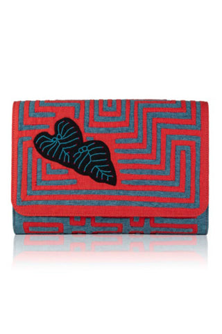 "Mola Sasa Resort 2019 Colocasia Clutch. Handmade woven cotton clutch featuring abstract ""mola"" design in red and teal. Features embroidered floral motif patch, striped interior lining, and magnetic button closure. 11.5 inches by 7 inches. Color red teal white. 100% cotton. Size large."
