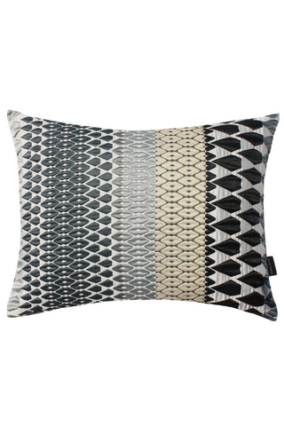 Iceni Present Cushion by Margo Selby. Inspired by the forms of cut jewels, and woven in a monochrome color scheme Iceni is an iconic Margo Selby fabric. Woven using mixed fibers including a heat-shri​nk yarn which creates a tension in the cloth to create an embossed-like surface. Color grey. 46% Cotton, 32% Acrylic, 22% Polyester.
