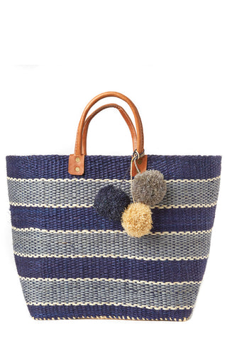 "The bold, festive stripes on Mar Y Sol's must-have Capri in Navy create a versatile and stylish accessory for a trip to the beach or strolling around town. 100% woven sisal with raffia pom poms, seagrass lining, inside pocket and leather handles. Structured handmade beach tote. Measurements 18""h x 13""w"
