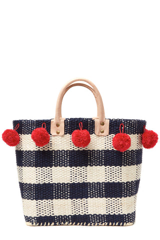 "Flirty pom poms, preppy plaid, and bold colors! What more could you ask for in a chic summer bag? The structured basket style of the Pompei Tote by Mar y Sol Spring 2018 also means it's roomy, so you can fit everything you need. Handwoven sisal and seagrass with raffia pom poms, an inside pocket and leather handles. Red and Blue. Measurements 14""h x 10""w x 6""d with a 5"" strap drop"