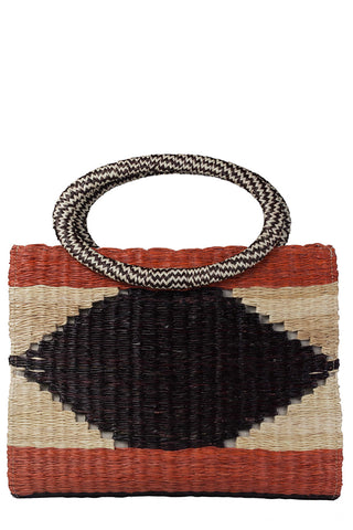 "Mola Sasa Earth Day Collection 2018 Vija Tote. Handwoven handle tote featuring bold graphic woven pattern and color block stripes. Round open top handles. Fully lined. Handmade in Colombia. 13.5"" x 11.5"" x 2"". Color black natural red. 100% woven Estera palm leaf. One size."