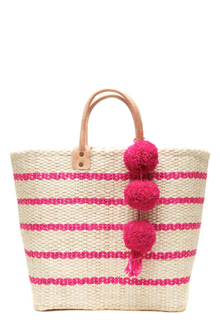"The Tybee Woven Tote in Pink by Mar y Sol Spring 2018 takes inspiration from a classic basket tote design, but features a slimmer silhouette that's versatile enough for both everyday and at-the-beach wear. Pinstripe and pom-pom chain embellishments give it a smart, understated look with just enough style to get noticed.100% woven sisal with raffia pompoms, seagrass lining, inside pocket and leather handles. Measurements 11.5""h x 14.5""w x 6""d 5"" strap drop"