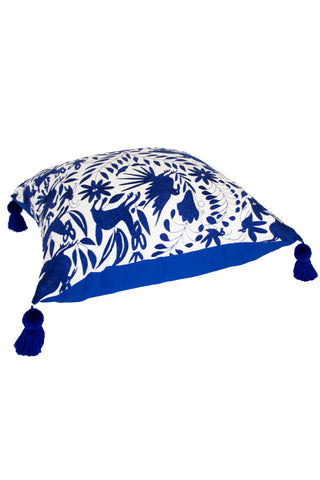 Oversized Royal Otomi Floor Pillow by Nativa. Hand embroidered in Mexico. These beautiful handmade floor pillows are hand embroidered with the fun and eccentric Otomi embroidery style. The backing is a royal blue canvas material with industrial zipper enclosure. Color blue. 100% cotton.