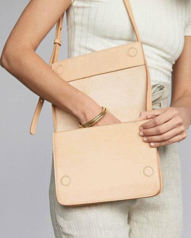 Clara Crossbody by Nisolo. Handmade in Mexico. Elegant, simple, and understated, you'll want to carry the Clara Crossbody purse all around town. With its structured, clean lines and natural vachetta leather, Clara is sure to make you stand out in the best way possible. Color natural. 100% genuine leather.