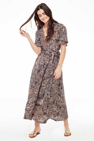 Osei-Duro Spring 2018 Tulip Dress in Snakebite. Ankle length feminine wrap dress with deep V crossover at center front. Elbow length flutter sleeves. Color hand dyed batik multi brown print. 100% rayon. Sizes X-Small Small Medium Large.