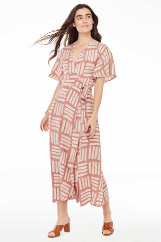 Osei-Duro Spring 2018 Tulip Dress in Pink Basket. Ankle length feminine wrap dress with deep V crossover at center front. Elbow length flutter sleeves. Color hand dyed batik pink print. 100% rayon. Sizes X-Small Small Medium Large.