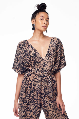Osei-Duro Spring 2018 Easy Jumpsuit in Snakebite. Loose fitting jumpsuit with self-tie, removable belt. Dolman sleeves and deep V at front and back neck. 21.5 inch inseam. Color hand dyed batik multi brown print. 100% Rayon. Sizes X-Small Small Medium Large.