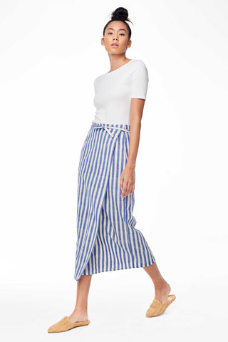Accompany Exclusive Proud Mary La Paz Skirt in Blue Natural Stripe. Striped wrap skirt in lightweight cotton. Waist tie for adjustable fit. Color blue and white stripe. 100% cotton. Sizes Small/Medium Medium/Large.