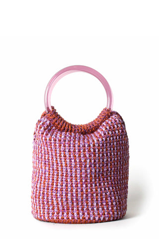 Rachel Comey Resort 2019 Praia Bag in Pink. Small and slouchy, this petite crocheted bucket bag from Rachel Comey is the perfect way to add a touch of retro style to any ensemble. Handmade mini crochet bag with acrylic ring handle. 100% pink and red cotton woven body. Unlined. Color purple. One size.