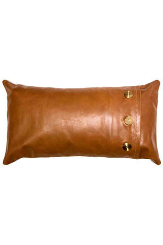 "Leather Safari Lumbar Pillow by Rose & Fitzgerald featuring brass button accents. Premium cotton insert included. Measurements 12"" x 20"" 100% leather Made in Uganda Rose & Fitzgerald is a design-and-craft studio based in Kampala, Uganda, founded by a Californian couple who wanted to merge their sense of coastal living and contemporary fashion with the beauty of the indigenous materials and craftspeople they encountered in their adopted home of Africa."