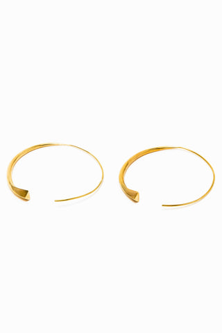 Raven and Lily Anya Hoop Earrings. Staple hoop earring made from recycled brass. Diamond cast brass hoops. Threader for pierced ears. Handmade by artisans in Kenya. 2 inch diameter. Color gold. 100% brass. Sizes Small Large.