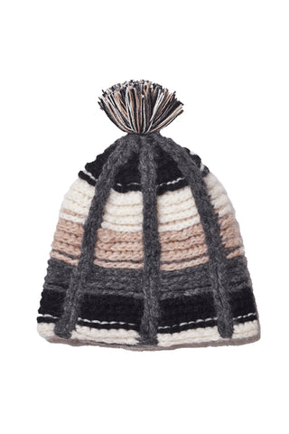 Chullo Knit Beanie by Siblings Army. Hand knit in Peru. Neutral woven striped pom pom beanie. Crafted by artisans. Color grey. Wool, alpaca and nylon blend.