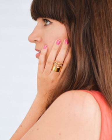 Accompany Exclusive Soko Notch Triple Band Ring. Luxe wrapped band detailing adds a delicate touch to this glam ring. Handcrafted in Kenya using traditional artisan techniques. Color gold. 100% recycled brass. Adjustable size.