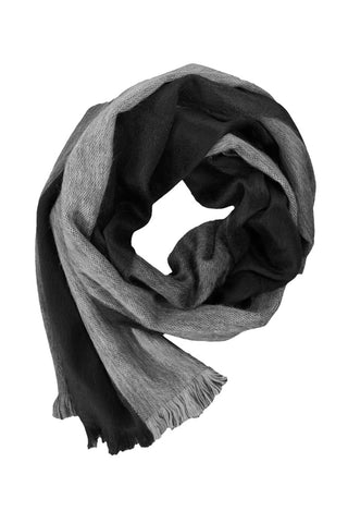 Reversible Brushed Wrap Scarf by Shupaca. Handmade in Ecuador. You can never go wrong with classic colors like black and grey. The Nightscape alpaca wrap will effortlessly add understated elegance to even the most basic outfits. Color black grey. 80% alpaca, 20% acrylic.