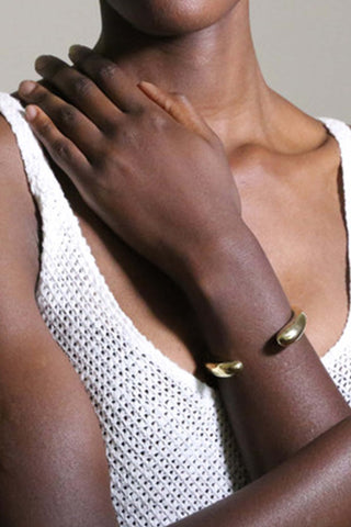 Soko Dash Cuff. Sculptural wrist cuff has leisurely arcs and nicely rounded endcaps. Hand-carved, super-modern cuff is so simple, yet packs a serious style punch. Handmade in Kenya using traditional artisan techniques. Colors silver gold. 100% recycled brass, chrome plating. Sizes Small/Medium Medium/Large.