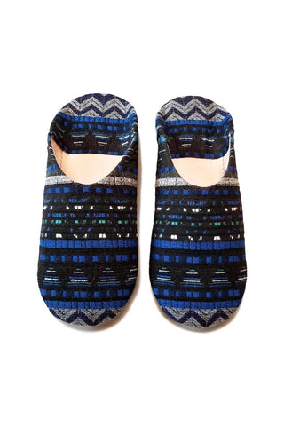 Blue Jay Moroccan Babouche Slipper by Socco Designs. Handmade in Morocco. These Moroccan babouche slippers are handcrafted from natural leather coated with custom printed fabrics to make them distinctively modern. The soft leather will fit like a glove when your first slide them on. Features a cushioned insole to provide more perfect comfort as you wander around the house. Color blue. 100% natural leather sole.