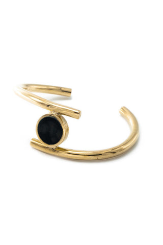 Soko Spring 2018 Lucine Statement Cuff Bracelet. Cast brass statement cuff with carved circular horn medallion accent. Handcrafted in Kenya using traditional artisan techniques. Color gold black. Recycled polished brass. Hand carved horn. Adjustable size.
