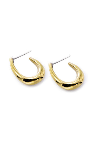 Soko Spring 2018 Mezi Mini Hoop Earring. Curved oval mini hoop huggie earring. Post fastening for pierced ears. Handcrafted in Kenya using traditional artisan techniques. Color gold. 100% recycled polished brass. One size.
