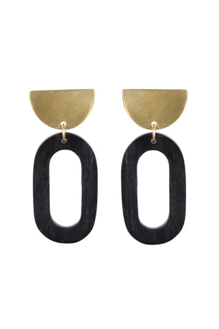 Soko Spring 2018 Sansa Horn Oval Earrings. Oversized sculptural statement earring featuring handmade geometric shapes. Post fastening for pierced ears. Handcrafted in Kenya using traditional artisan techniques. 2 inch drop. Color black gold. Polished recycled brass. Hand carved horn. One size.