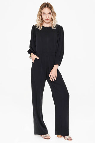 Sitting Pretty Fall 2018 Lila Panelled Jumpsuit in Black. Flared leg jumpsuit featuring cropped tapered sleeves and a slight drop waist. Round neckline with front and back yoke. Front zip closure. Gathered shoulder with wide cuff. Slant pockets. Regular fit. Made in South Africa. Color black. 100% rayon twill. Sizes small medium large.