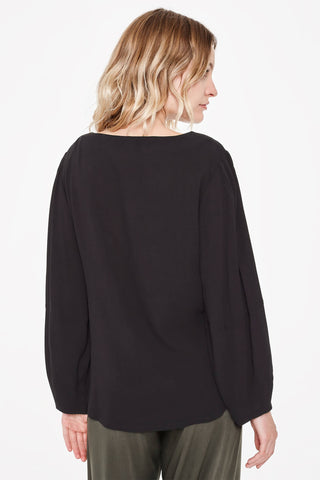 Sitting Pretty Fall 2018 Sofia Loose Tapered Blouse in Black. Long sleeved tapered blouse featuring a round neckline and curved hem. Relaxed fit. Made in South Africa. Color black. 100% rayon crepe. Sizes small medium large.