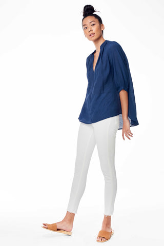 Accompany Exclusive Sitting Pretty Asmara Top in Carbon. Loose oversized blouse with gathered split V-neckline, three quarter sleeve, gathering at back panel, dipped curved back hem. Pull over style. Measures 24 inches from shoulder to hem. Color navy. 100% ghost chiffon. Sizes Small Medium Large.
