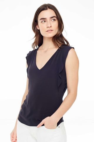 Sitting Pretty Spring 2018 Emmeline Top in Black. Waterfall sleeve V-neck top with curved hem. Loose fitting. Small measures 25 inches. Color Black. 100% rayon crepe. Sizes Small Medium Large.