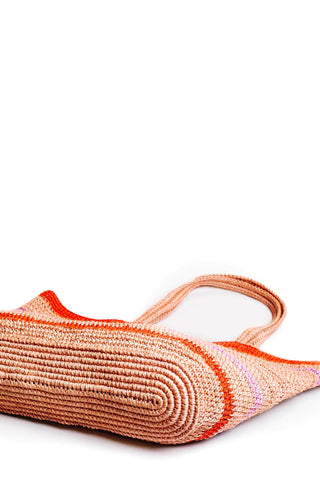 "Someware Lola Tote in Guava stripe. Hand crocheted large handle over the shoulder tote featuring slouchy structure and bright colorblock stripes. Open top. Unlined. Handmade in Colombia. 14"" x 20"" x 4"". 7.5"" strap drop. Color tan pink orange. 100% fique. One size."