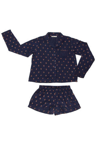 Accompany Exclusive Sitting Pretty Holiday 2017 Painted Stars PJ Set in Navy and Rose Gold. Printed cotton PJ set of 2. Long sleeved pajama style button up top with piping. Rounded collar. Front patch pocket with rose gold embroidery. Shorts with elastic wast and piping at hem. All over block printed rose gold star print. Unlined. Comfortable fit. Color Navy Blue and Rose Gold. 100% rayon. Sizes Small Medium Large.