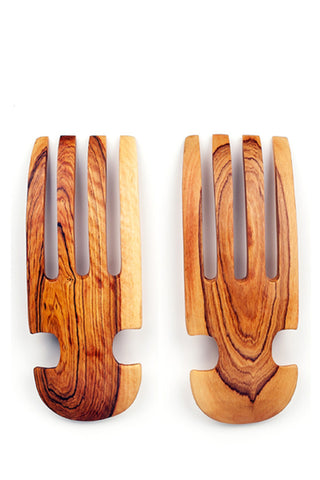 Wild Olive Wood Salad Claws by Swahili Modern. Handmade in Kenya. Bring traditional African design into the modern kitchen with these unique salad servers featuring white bone inlay. These exceptional servers are hand-carved from a single piece of olive wood and hand-sanded to a smooth finish. Color natural. 100% olive wood. Upcycled bone.