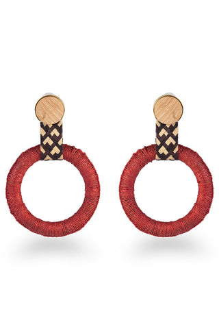 "Mola Sasa Earth Day Collection 2018 Maguey Hoop Earring in Terracotta. Wrapped oversized hoop statement earrings featuring contrast woven drop and wood post fastening. Post earring. Handmade in Colombia. 4"" drop. 2.4"" hoop diameter. Color red. 100% woven agave fiber. One size."