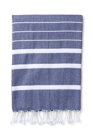 "The Ibiza Hammam Towel in Lipstick Red, Navy or Mocha is woven in Turkey from soft cotton with hand knotted tassels. Hammam towels, or pestemals as they are known in Turkey, are great for the home or holidays. Super absorbent, quick drying, lightweight and easy to pack; they make great sarongs, beach and spa towels, picnic blankets or throws. Ethically Handmade in Turkey 100% Cotton Measurements70""L x 35""W"