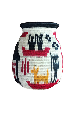 Wounaan Art Vase by Tulia's Artisan Gallery. Handcrafted in Colombia. One of a kind statement home decor vase with an ethnographic design. All handcrafted by award-winning indigenous Wounaan artisans of Colombia. Color multi. 100% palm leaf.