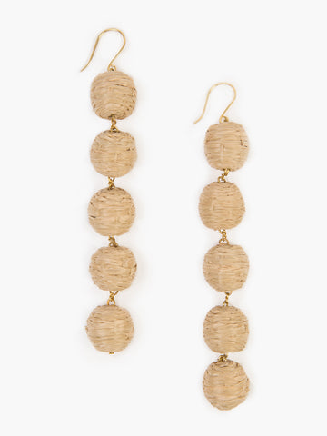 Chan Luu 5 Tier Raffia Pom Pom Earring in Doeskin. Wrapped raffia pom pom drop earring. 4 inch drop. Fishhook fastening for pierced ears. Colors Nude Olive Green Blue Grey. One size.