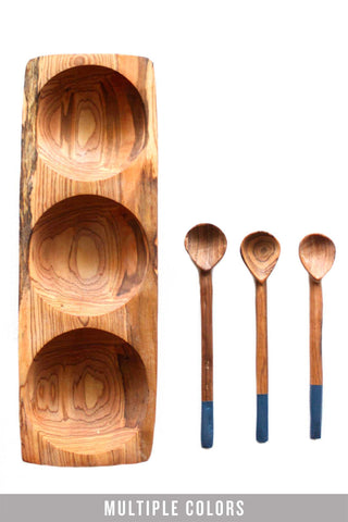 Tatu Tray by Badala. Handmade in Kenya. This food-safe tray can be used for a trio of your favorite dips or seasonings - or take it out of the kitchen and use it as a desk accessory. The olive wood Tatu tray includes three paint dipped serving scoops. Made from native olive wood tray and serving scoop set with painted detail. Made by local people in Makueni County and Nairobi. Color faded navy. 100% olive wood.