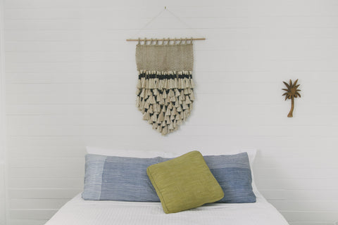 "Add a touch of vintage style to your decor with The Dharma Door's Jute Macrame Wall Hanging with oversized tassels. Naturally-dyed indigo adds a hint of on-trend color. Dimensions: 25-1/2"" high x 17-3/4"" wide Handcrafted by Fair Trade artisans in Bangladesh. *Wooden dowel not included. Alternate color: Natural"